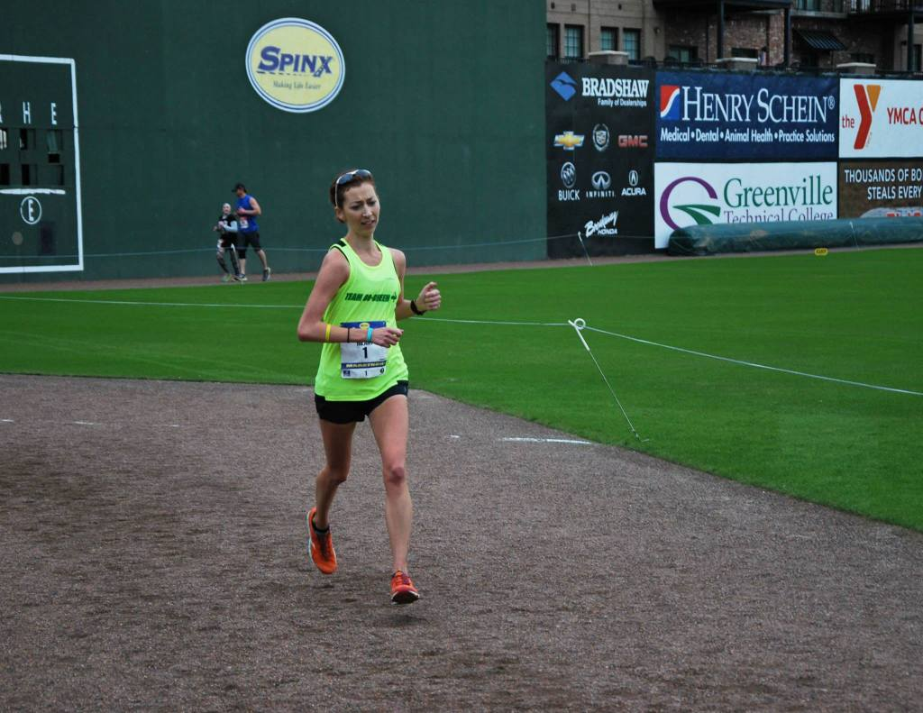 I love finishing inside the Fluor Field baseball stadium...actually, I just love finishing at all! Photo Credit: Pace Running Magazine